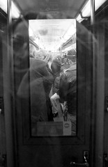 a prelude to a kiss (merita selimi) Tags: people blackandwhite bw paris france reflection underground subway french kiss noiretblanc metro mtro nb reflet bardhezi