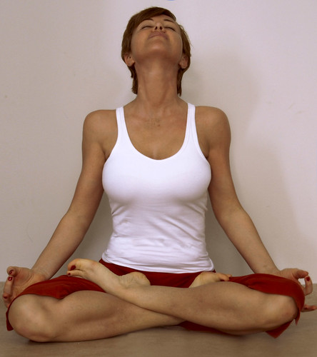 Busty yoga model in lotus position