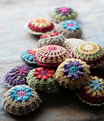 more pincushions (namolio) Tags: blue motif yellow purple handmade linen crochet round pincushion