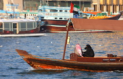 Dubai creek (Kate_Lokteva) Tags: travel woman water creek boat dubai ship islam uae middleeast hijab traveller emirates sailor shipping niqab unitedarabemirates             arabianpeninsula  unitedarabianemirates   ekaterinalokteva photographerekaterinalokteva    ekaterinaloktevaphotographer
