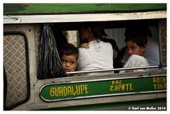 The humdrum of travel (Karl von Moller) Tags: manila jeepney thephilippines passengersonajeepney