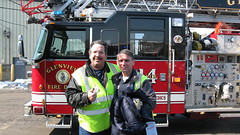 First Transit paratransit drivers Eddie K and his friend Mike posing by a Glenview Fire Department ladder truck. Glenview Illinois. Saturday, March 6th 2010.