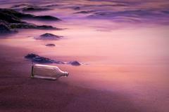 Message In A Bottle (michaeljosh) Tags: longexposure sunset mist beach bottle sand rocks shore tanduay nikkor50mmf14d messageinabottle ndfilter project365 pagudpodilocosnorte trashonthebeach nikond90 lettertoflickrfriends michaeljosh iilocosroadtrip
