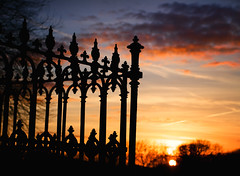 Lights out (archidave) Tags: sunset sun colour grave silhouette clouds evening iron tomb victorian cast churchyard railing pembrokeshire stdavids clichesunsetshot