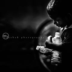 Brand Manager (ayashok photography) Tags: morning light boy india asian kid bottle nikon asia play indian dude desi tamilnadu bharat bharath desh barat barath nikkor70300mm nikonstunninggallery ayashok nikond300 semponkudi dsc3911bw1x1