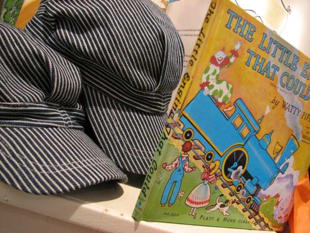 train book and hat