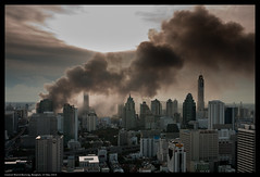 Central World Burning (Mike Hohman) Tags: world sky skyline thailand fire evening riot war cityscape dusk bangkok smoke central protest battle burning burn yellows reds may19 rioting civilunrest ratchaprasong totallythailand