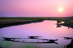 paradise! (Tahsin Hossain) Tags: life sunset sun color reflection green nature water beauty field kids rural children landscape boat nikon colorful natural pair lifestyle land serene unreal 18200 bangladesh sinking haor d90 tahsin shunamganj tanguar valst