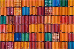 containers (heavenuphere) Tags: rotterdam netherlands nederland port harbour shipping container containers freight cargo transport orange red blue green zuidholland southholland europe 55250mm gi 52