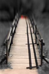 When you can't see whats ahead (Simon in Southend) Tags: wood bridge red blur lines mystery lensbaby wooden other focus side over creative mysterious desaturated railings lensbabies planks source unsure composer selective taiz taize leadin