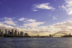Skyline, Sydney Harbour (Steve.M~) Tags: light sunset sea sky holiday water skyline clouds boat focus skyscrapers oz sony horizon sydney australia alpha dslr a200 sydneyoperahouse sydneyharbourbridge centralbusinessdistrict lightroom sonyalpha200