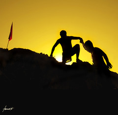The Strength Of The Human Spirit. (Tomasito.!) Tags: charity friends sunset red portrait people sun mountain love apple beautiful silhouette yellow rural photoshop movie macintosh island gold climb mac nikon rocks asia hand power friendship arms bright flag philippines hill mountainclimbing joy dramatic surreal adventure help human brotherhood coron judelaw jt inspiring touristspot palawan noriega helpinghand humanspirit cs4 tomasito gattaca d90 umatherman philippinetouristspot mygearandmepremium mygearandmebronze mygearandmesilver mygearandmegold ethanehawke bestplacetovisitphilippines