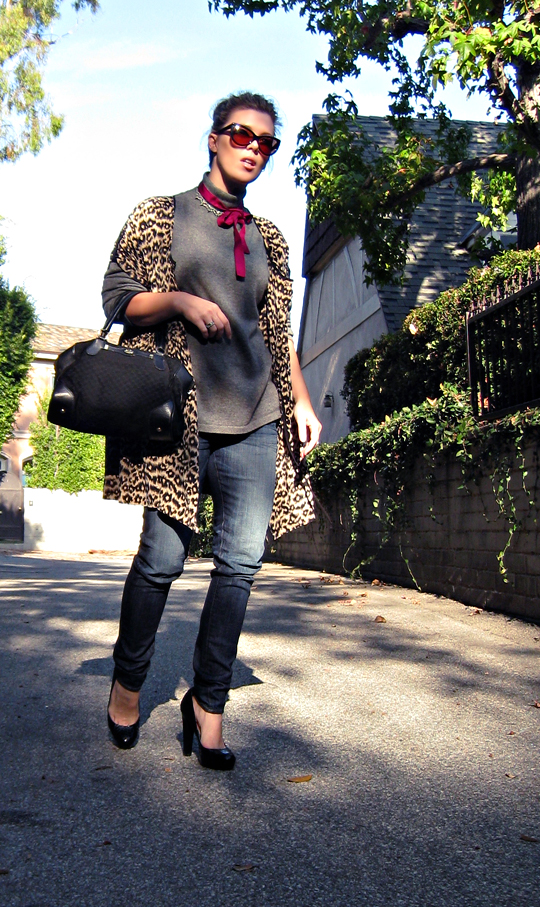 street style+la style+leopard print dress as jacket over jeans and a sweater+sharp