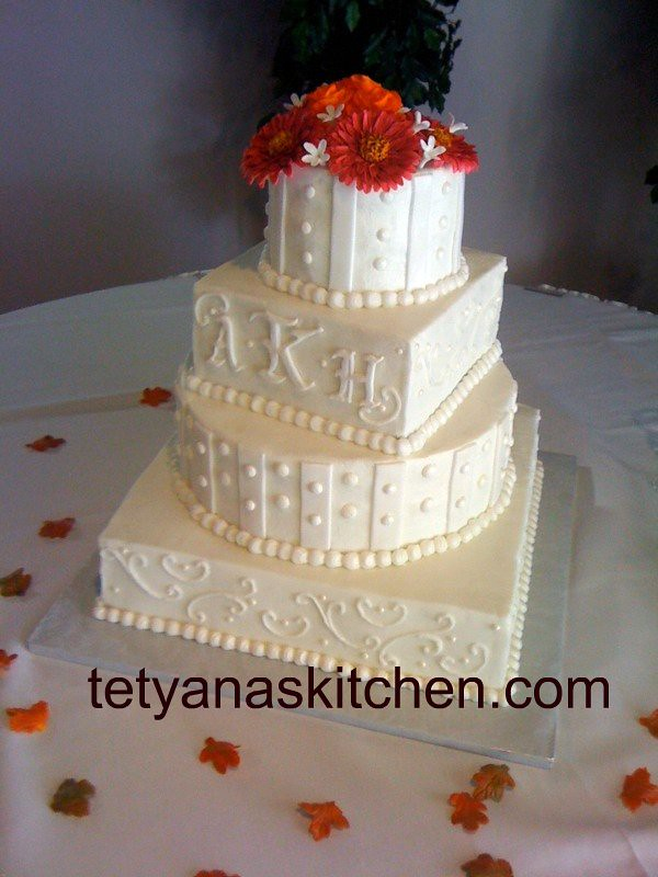 White wedding cake with hand made flowers