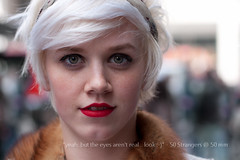 50 - yeah, but the eyes aren't real... look :-) - 50 Strangers @ 50 mm (r c hill photography) Tags: street red portrait white green london girl beauty canon hair 50mm eyes dof shot natural bright bokeh head f14 gorgeous strangers stranger headshot lips piercing short blonde stunning shallow platinum beatiful
