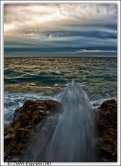 Ocaso... (Pilar Lozano ) Tags: mar agua cielo nubes olas seda ocaso rocas efecto electra100