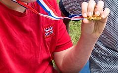 Everyone gets Gold (sasastro) Tags: goldmedal grandson