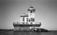 Oswego Harbor West Pierhead Lighthouse (neilsonabeel) Tags: upstatenewyork newyork greatlakes lake nikonactiontouch nikon oswego lighthouse film analogue blackandwhite