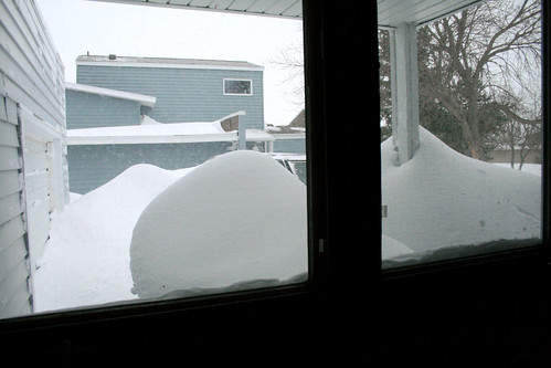 Out the kitchen window, the drifts blocked the garage and part of Philip's truck.