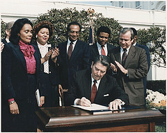Photograph of President Reagan and the Signing Ceremony for Martin Luther King Holiday Legislation, 11/02/1983 - 11/02/1983