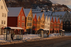 Waiting for the bus (halifaxlight (catching up)) Tags: brown white mountain snow norway waiting sunny shops bergen ochre bryggen shelters busstops theperfectphotographer