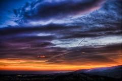 Sky of war (futhark) Tags: blue sunset sea sky orange sun black mountains lines clouds canon landscape atardecer mar high war meer skies dynamic angle cloudy wide dramatic paisaje cielo vignetting range hdr highdynamicrange photomatix 40d