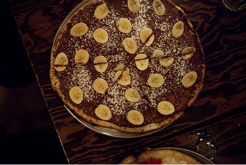 Nutella pizza with pear and powdered sugar