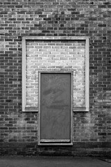 (Delay Tactics) Tags: door blue bw white black window wall square graffiti sheffield bricks running bond exit rectangle bennett