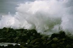 Crashing The Jetty (rahtenkhamen) Tags: film gimp wave pacificocean centralcoast pentaxmesuper morrobayca canonmp960scanner searsrikenonmulticoatedf28135mm fujisuperia400rebrandedriteaiddrugstorefilm