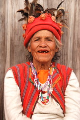 Ifugao Woman 1, Banaue, Northern Luzon, Philippines (Damon Tighe) Tags: portrait people woman smile hat clothing asia rice native traditional philippines terraces feathers photojournalism banaue ifugao riceterraces necklaces missingteeth damontighe