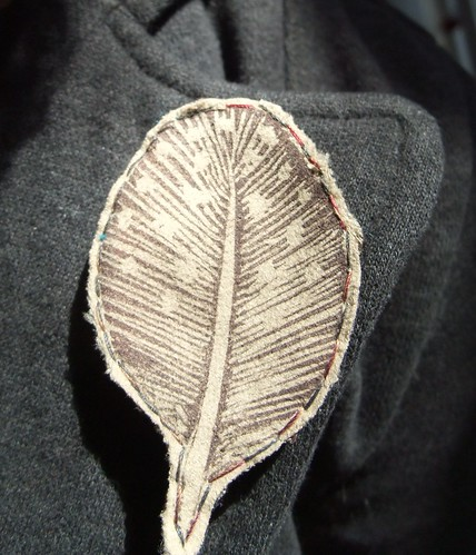 feather on lapel