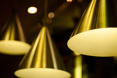 Bizu Lamps (michaeljosh) Tags: white dessert gold lights bokeh depthoffield dining lamps winebottles champange nikkor50mmf14d hanginglamps nikond90 bizulamps bizugreenbelt2