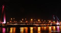 Willemsbrug at night in Rotterdam (Mitch.Montana) Tags: bridge light red apple monument skyline night dark rotterdam aperture nikon glow slow blaak erasmus nederland trails nightlife maas