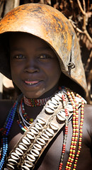 Arbore child wearing a calabash (ingetje tadros) Tags: africa travel geotagged embroidery african jewelry tribal ethiopia ethnic ethiopian omo arboretribe weytovalley