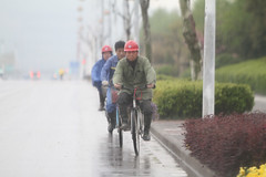 Getting Home (Barry Zee) Tags: china hardhat rain bicycle traffic police prc nanjing obvious efficiency peoplerepublicofchina savetime