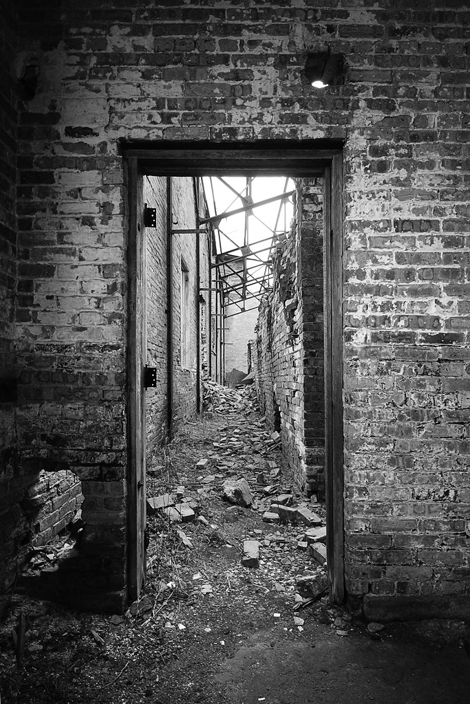 A brick doorway looking down a long corridor.