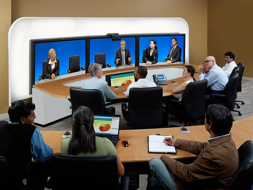 Meeting participants collaborate using the Cisco TelePresence System 3200 and the Cisco Tandberg T3