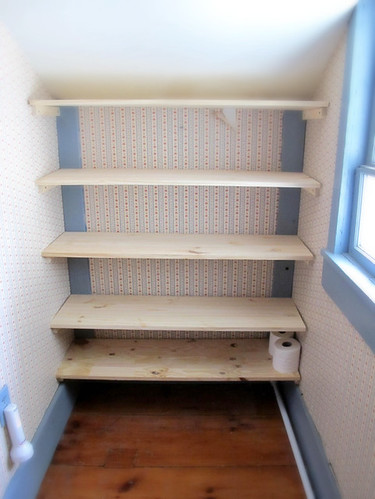 new shelves awaiting their linens