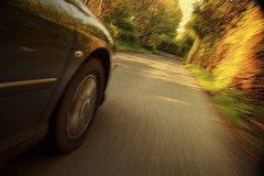 Road (Stuart Stevenson) Tags: road trees light motion car wheel moving movement blurred panning ido goldenhour blurgh challenge5 creativetribe canon5dmkii ©stuartstevenson dontviewthelargeversionifyousufferfrommotionsickness
