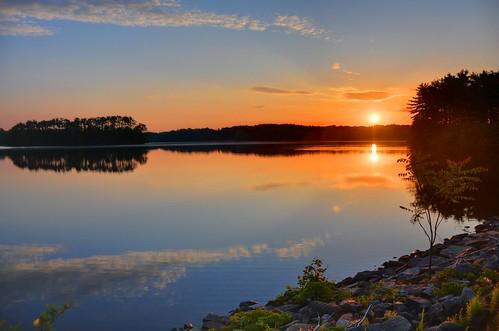 Morning sunrise over metro Boston reservoir
