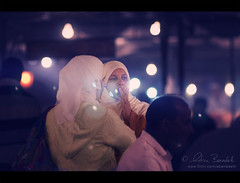 twilight sisters () Tags: africa street portrait andy night photography evening twilight women strada veil market andrea muslim hijab lightbulbs andrew morocco marocco marrakech donne marrakesh fotografia mercato ritratto notte velo sera gloaming benedetti lampadine mussulmano 135mmf2 nikond90