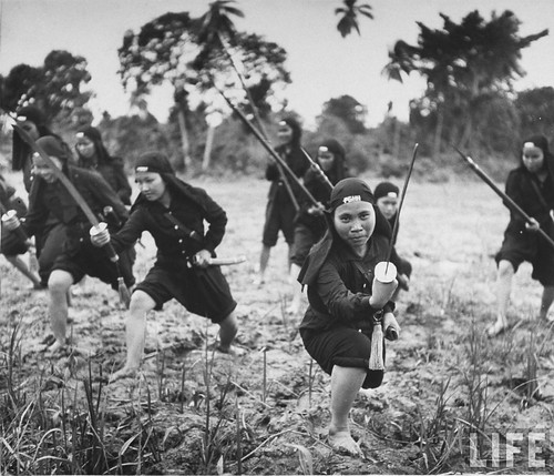 July 1948 - Hoa Hao women's troops training for jungle war with sabers, in French Indo China.