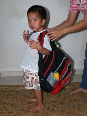 Julian carrying bag