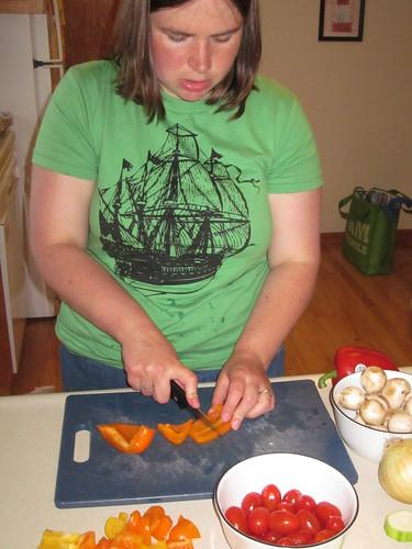 Sarah chops vegetables