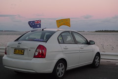 Fish and Football (Mariasme) Tags: sunset seagulls beach toyota christianity worldcup australianflag caradvertising 2219 dollspoint footballfever