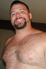 Furry Chest & Electric Eyes (canadianlookin) Tags: bear woof june furry winnipeg skin glbt pride kendall 2010