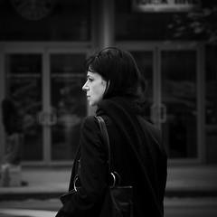 (Vitaliy P.) Tags: street new york city nyc light bw woman sun white black monochrome scarf bag square photography back nikon crossing cross natural head manhattan candid midtown jacket purse crop turned left handbag wating 55200mm d80 vitaliyp