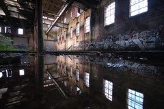 Reflections... (Sam Tait) Tags: old windows england reflection building water silver d50 puddle graffiti nikon factory angle wide sigma railway warehouse abandonded puddles 1020 derelict derby friargate