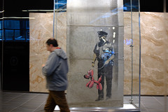 banksy on the PATH under glass (Ian Muttoo) Tags: dsc84801edit toronto ontario canada gimp ufraw path banksy oneyork 1york oneyorkst oneyorkstreet 1yorkst 1yorkstreet art glass graffiti motionblur reflection reflections stencil