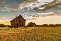 Old Homestead (http://fineartamerica.com/profiles/robert-bales.ht) Tags: barn buildings fineart flickr gemcounty haybales idaho old people photo photouploads places states sunrise sunset house farm homestead ranch cattle barnwood fence butte squawbutte mountain idado landscape emmett treasurevalley scenicbiway americaphotography valley idahophotography beautiful sensational spectacular awesome magnificent peaceful surreal sublime magical spiritual inspiring inspirational canonshooter scenic wow stupendous superb building grass hay trees yellow blue robertbales sky